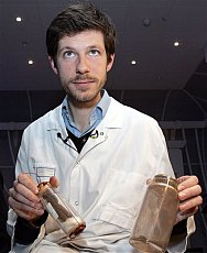 AP Photo: Dr. Charlier displays the supposed remains of Joan of Arc