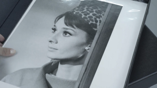 Promotional still of Hepburn in Charade on display in Christie's promotional video