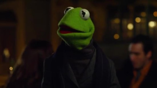 Kermit is wearing a slate grey Armani cashmere blazer accented with a stunning midnight black silk scarf...